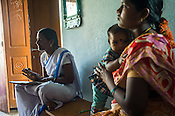 An Accredited Social Health Activist (ASHA) worker monitors the vaccinations to infants and mothers at the local health centre in Gorikothapally Village in Warangal district in Andhra Pradesh, India.