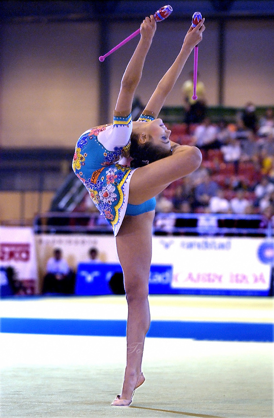 October 19, 2001; Madrid, Spain:  ALINA KABAEVA of Russia performs with clubs at 2001 World Championships at Madrid.