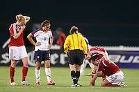 Referee Sandra Serafini checks on Canada forward Melissa Tancredi (14) who was injured. The women's national team of the United States defeated Canada 6-0 during an international friendly at Robert F. Kennedy Memorial Stadium in Washington, D. C., on May 10, 2008.