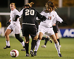 Florida State's Mami Yamaguchi (18) has the ball knocked away from Wake Forest's Caitlin Farrell (20) on Friday, November 3rd, 2006 at SAS Stadium in Cary, North Carolina. The Florida State University Seminoles defeated the Wake Forest University Demon Deacons 4-2 on penalty kicks after their Atlantic Coast Conference Women's Soccer Championship semifinal game ended in a 0-0 overtime tie.