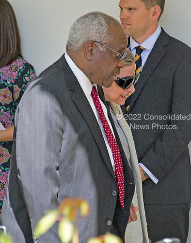 Associate Justice of the United States Supreme Court Clarence Thomas, left,walks with fellow Associate Justice Ruth Bader Ginsburg on the Colonnade following the ceremony where Associate Justice Neil Gorsuch took the Oath of Office from Associate Justice Anthony Kennedy in the Rose Garden of the White House in Washington, DC on Monday, April 10, 2017.<br /> Credit: Ron Sachs / CNP<br /> (RESTRICTION: NO New York or New Jersey Newspapers or newspapers within a 75 mile radius of New York City)