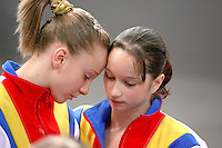 Sept 5, 2007; Stuttgart, Germany;  (L-R) Sandra Izbasa and Steliana Nistor of Romania feel the emotions after their team won bronze in the women's artistic gymnastics team final at 2007 World Championships. Photo by Copyright 2007 Tom Theobald.