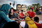 """Ruben, 20, right, hangs out with friends at an Aceh Youth Forum, which supports Aceh's youth through art and dance, during their third official show, in Banda Aceh, Indonesia, Monday, Nov. 16, 2009. The organization is comprised of 73 youth groups in Aceh Province. """"We are not afraid of Sharia Law because we do this for the development of Achnese youth,"""" says Ocxie, 23, the organizer of the group."""