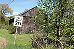 Speed limit 30 MPH sign in front of a barn in Hadley, MA