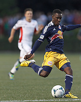 New York Red Bulls midfielder Lloyd Sam (10) takes a shot. 2013 Lamar Hunt U.S Open Cup fourth round, New England Revolution (white) defeated New York Red Bulls (blue/yellow), 4-2, at Harvard University's Soldiers Field Soccer Stadium on June 12, 2013.