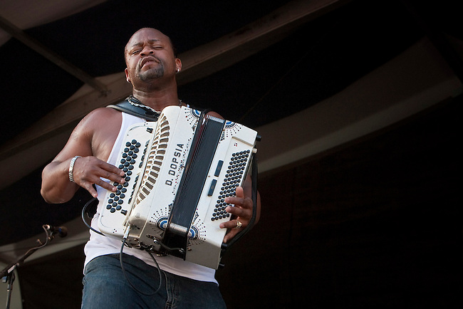 Louisiana born Zydeco accordionist and singer Dwayne Dopsie and his band Dwayne Dopsie and the Zydeco Hellraisers performing on the Fais Do-Do stage at the New Orleans Jazz and Heritage Festival at the New Orleans Fair Grounds Race Course in New Orleans, Louisiana, USA, 25 April 2009.