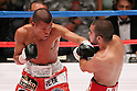 (L to R) Koki Kameda (JPN),  David De La Mora (Mex), AUGUST 31, 2011 - Boxing : Koki Kameda of Japan in action against David De La Mora of Mexico during the WBA Bantam weight title bout at Nippon Budokan, Tokyo, Japan. Koki Kameda of Japan won the fight on points after twelve rounds. (Photo by Yusuke Nakanishi/AFLO SPORT) [1090]