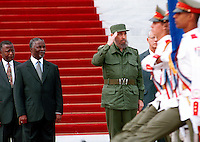 "South African president Thabo Mbeki and his Cuban countepart Fidel Castro review the presidential guard, in Havana March 27, 2001 at the Revolution Palace. This is the second day of a four-day visit by the South African leader to the communist-ruled Caribbean island, which was a prominent backer of the armed struggle against apartheid. Sign reads ""State Council."" Credit: Jorge Rey/MediaPunch"