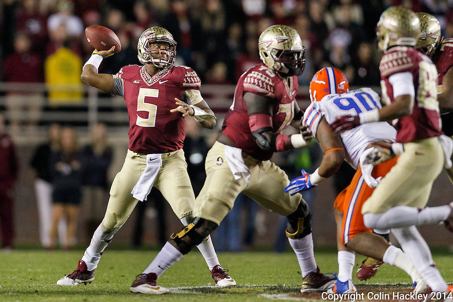 TALLAHASSEE, FL 11/29/14 FSU-UF112914-Florida State's Jameis Winston throws against the University of Florida during second half action Saturday at Doak Campbell Stadium in Tallahassee. The Seminoles beat the Gators 24-19.<br /> COLIN HACKLEY PHOTO