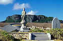 Japanese memorial Heiwa Kannon, the Peaceful Goddess of Mercy, with Suicide Cliff in distance; island of Saipan.