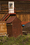 Rusting metal outhouse in a ghost town, Colorado