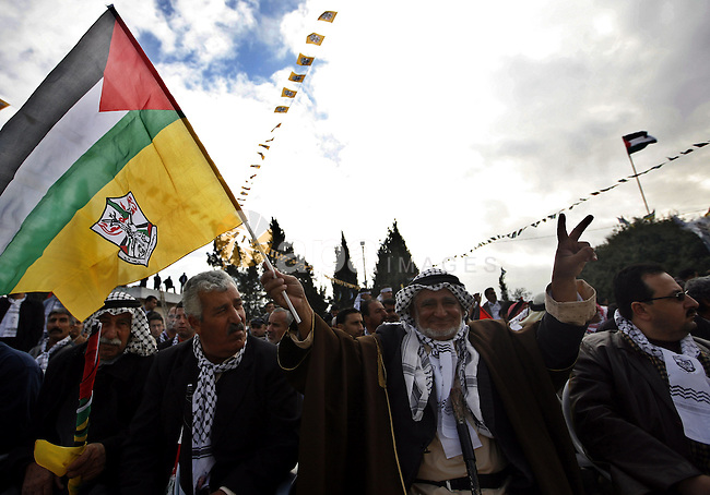 Palestinian Fatah supporters gather during a rally to mark the upcoming 46th anniversary since the group's foundation in the West Bank town of Toura Al-Gharbeyyeh, near Jenin, Saturday, Jan. 1, 2011. Photo by Wagdi Eshtayah