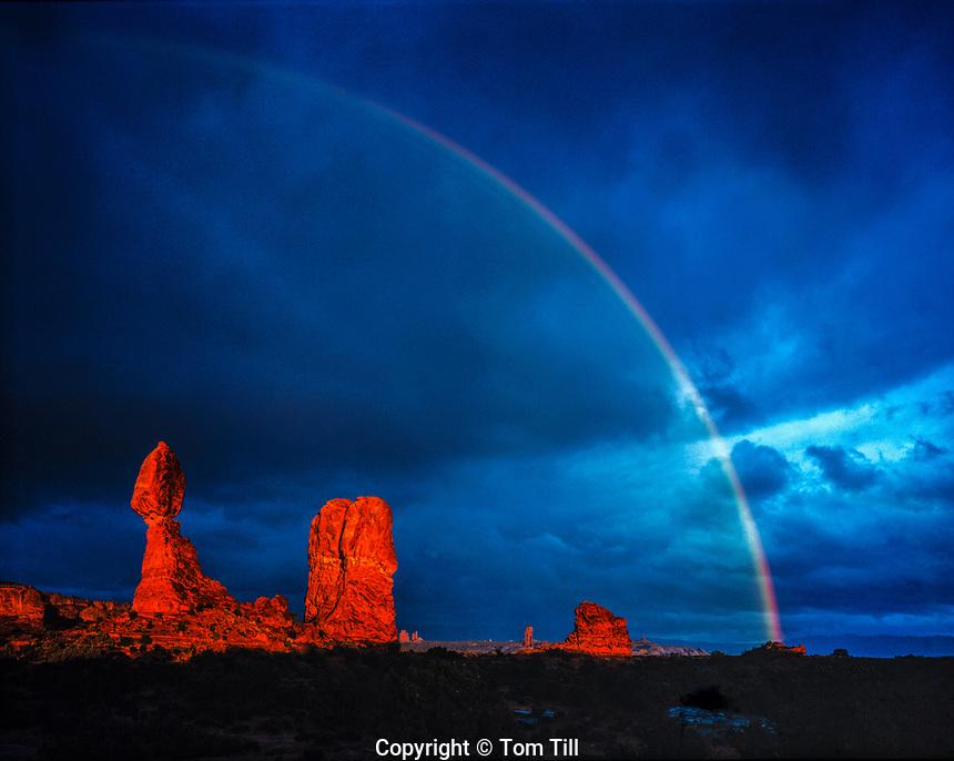 Rainbow at Balanced Rock, Arches National Park, Utah Stormlight at sunset Entrada sandstone