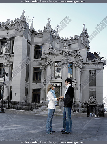 Romantic young couple meeting under the House with Chimeras in Kiev which was built by Vladislav Gorodetskiy in 1901-1903 for his family and has many legends connected to it This is one of the architectural landmarks in Kyiv Ukraine