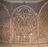 Carved decoration in Mirhab of the Ben Youssef Madrasa, Medina, Marrakech, Morocco. The Madrasa is an Islamic theological college founded in the 14th century and rebuilt by the Saadians in the 1560s. It is named after the Almoravid Sultan Ali ibn Yusuf, who reigned 1106-42. The mihrab is a niche indicating the direction of the Kaaba in Mecca for prayer and is intricately carved. Picture by Manuel Cohen
