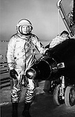 X-15 Pilot Neil Armstrong, later the first human to walk on the moon, next to the X-15.  This joint program by the National Aeronautics and Space Administration (NASA), the United States Air Force, the United States Navy, and North American Aviation, Inc. operated the most remarkable of all the rocket research aircraft. Composed of an internal structure of titanium and a skin surface of a chrome-nickel alloy known as Inconel X, the X-15 had its first, unpowered glide flight on June 8, 1959, while the first powered flight took place on September 17, 1959. Because of the large fuel consumption of its rocket engine, the X-15 was air launched from a B-52 aircraft at about 45,000 ft and speeds upward of 500 mph. The airplane first set speed records in the Mach 4-6 range with Mach 4.43 on March 7, 1961; Mach 5.27 on June 23, 1961; Mach 6.04 on November 9, 1961; and Mach 6.7 on October 3, 1967. It also set an altitude record of 354,200 feet (67 miles) on August 22, 1963, and provided an enormous wealth of data on hypersonic air flow, aerodynamic heating, control and stability at hypersonic speeds, reaction controls for flight above the atmosphere, piloting techniques for reentry, human factors, and flight instrumentation. The highly successful program contributed to the development of the Mercury, Gemini, and Apollo piloted spaceflight programs as well as the Space Shuttle program. The program's final flight was performed on October 24, 1968.