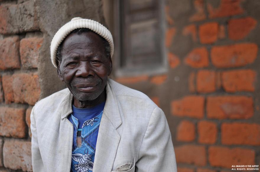Man in white hat - Kuntonda Village - Mulanje District - Malawi Africa