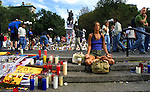 Jennifer Schumacher of Manhattan meditates amongst a vast evolving memorial at Washington Park which started with a one single candle following the 9/11 attacks on the World trade Towers nearby..