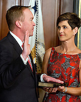 Former United States Representative Mick Mulvaney (Republican of South Carolina), left, takes the oath of office to be Director of the Office of Management and Budget (OMB) in the Vice President's Ceremonial Office at the White House in Washington, DC on Thursday, February 16, 2017. Mulvaney's wife, Pamela West Mulvaney, holds the Bible at right.<br /> Credit: Ron Sachs / Pool via CNP /MediaPunch