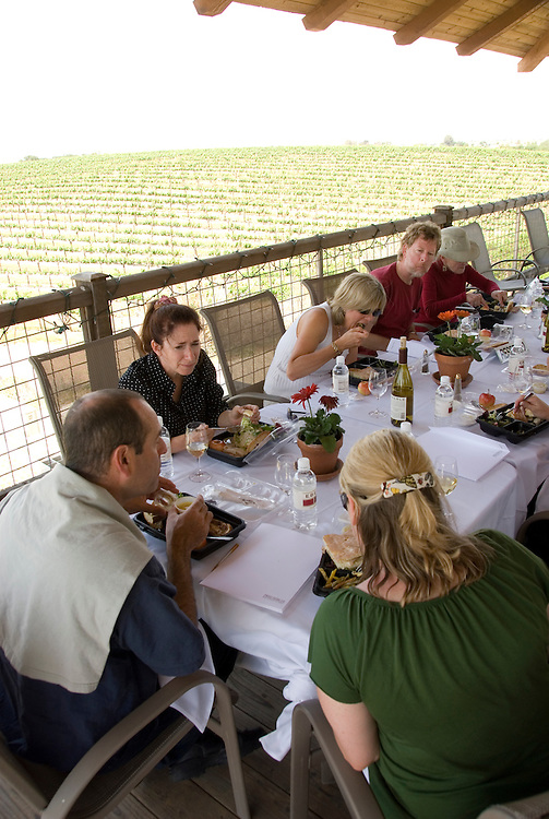 California, San Luis Obispo County: At Eberle Winery and vineyards in Paso Robles, noted for red wines.  Lunch on deck at winery with vineyards in background..Photo caluis138-70795.Photo copyright Lee Foster, www.fostertravel.com, 510-549-2202, lee@fostertravel.com