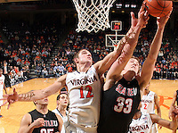Dec. 22, 2010; Charlottesville, VA, USA; Virginia Cavaliers guard Joe Harris (12) goes after the rebound with Seattle Redhawks forward Gavin Gilmore (33) during the game at the John Paul Jones Arena. Seattle Redhawks won 59-53. Mandatory Credit: Andrew Shurtleff