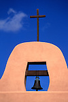 USA, New Mexico, Santa Fe. Bell and cross at San Ildefonso Pueblo.