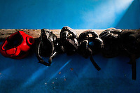 Boxing headgear hung on the rack in the boxing change room in Lima, Peru, 2 July 2013.