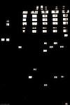 The lit by interior light window of a skyscraper in the dark.