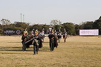 The band marches the teams on to the field before a game between the Royal Jaipur Polo Team (in pink) and the Western Australia Polo Team (in black) for the Argyle Pink Diamond Cup, organised as part of the 2013 Oz Fest in the Rajasthan Polo Club grounds in Jaipur, Rajasthan, India on 10th January 2013. Photo by Suzanne Lee