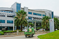 One of the many multi-national companies in Bangalore India, Microsoft has set up a huge campus in the Diamond District. This contrasts starkly with the rural poverty nearby.