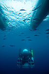 Cocos Island, Costa Rica; the DeepSee submarine fully submerged below the hull of it's transport boat, ARGO, after returning from a 300 foot dive to Everest