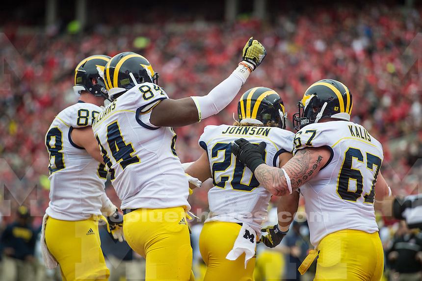 The University of Michigan football team falls to Ohio State, 42-28, at Ohio Stadium in Columbus, Ohio, on Nov. 29, 2014.
