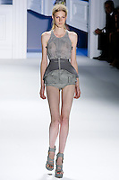 Julia Nobis walks runway in a Grey stripes linen-silk zip top with yoke detail and super pique double layer drawstring peplum belt, and Grey mackintosh cotton peplum boy shorts with cutout pocket detail, by Vera Wang, for the Vera Wang Spring 2012 collection, during Mercedes-Benz Fashion Week Spring 2012.