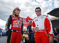 "Sep 2, 2016; Clermont, IN, USA; ""Papa John"" Schnatter (right) founder of Papa Johns Pizza with NHRA top fuel driver Leah Pritchett prior to a charity match race at Lucas Oil Raceway. Papa John's and Don Schumacher Racing put up $10,000 each for Riley's Hospital for Children, adding $20,000 to funds already raised through pizza sales earlier in the day. Mandatory Credit: Mark J. Rebilas-USA TODAY Sports"