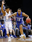 Kentucky Wildcats guard Isaiah Briscoe drives up the court against North Carolina Tar Heels guard Nate Britt during the 2017 NCAA Men's Basketball Tournament South Regional Elite 8 at FedExForum in Memphis, TN on Friday March 24, 2017. Photo by Michael Reaves   Staff