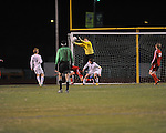 Oxford High's Henry Webb stops a shot vs. Neshoba Central in MHSAA playoff soccer action in Oxford, Miss. on Tuesday, January 22, 2013. Oxford won 3-1.
