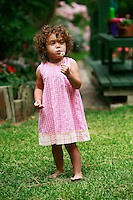 13 July 2008:  Two year old toddler Maya Gabriella Jaramillo plays in the back yard wearing a summer dress.  Mother is caucasion white American woman, father is a Mexican immigrant from Chiapas.  Mutli- Racial Family. This young girl is biracial.