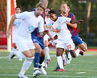 Dan Lader #12 of Crystal Palace Baltimore grabs hold of Gregory Richardson #20 of the Carolina Railhawks during an NASL match at Paul Angelo Russo Stadium in Towson, Maryland on September 18 2010. Carolina won 4-2.