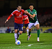 York City's Sean Newton under pressure from Lincoln City's Lee Angol<br /> <br /> Photographer Andrew Vaughan/CameraSport<br /> <br /> The Buildbase FA Trophy Semi-Final First Leg - York City v Lincoln City - Tuesday 14th March 2017 - Bootham Crescent - York<br />  <br /> World Copyright &copy; 2017 CameraSport. All rights reserved. 43 Linden Ave. Countesthorpe. Leicester. England. LE8 5PG - Tel: +44 (0) 116 277 4147 - admin@camerasport.com - www.camerasport.com