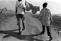 Young boys carry a banner as they lead a group of girls to be awarded their certficates of virginity after two years of testing in the village of Magqabasini, near Flagstaff in the former Transkei July 21, 1999.  The tradition of testing girls for virginity has been revived in an effort to prevent child abuse, teenage pregnancies and the spread of HIV. (Greg Marinovich)