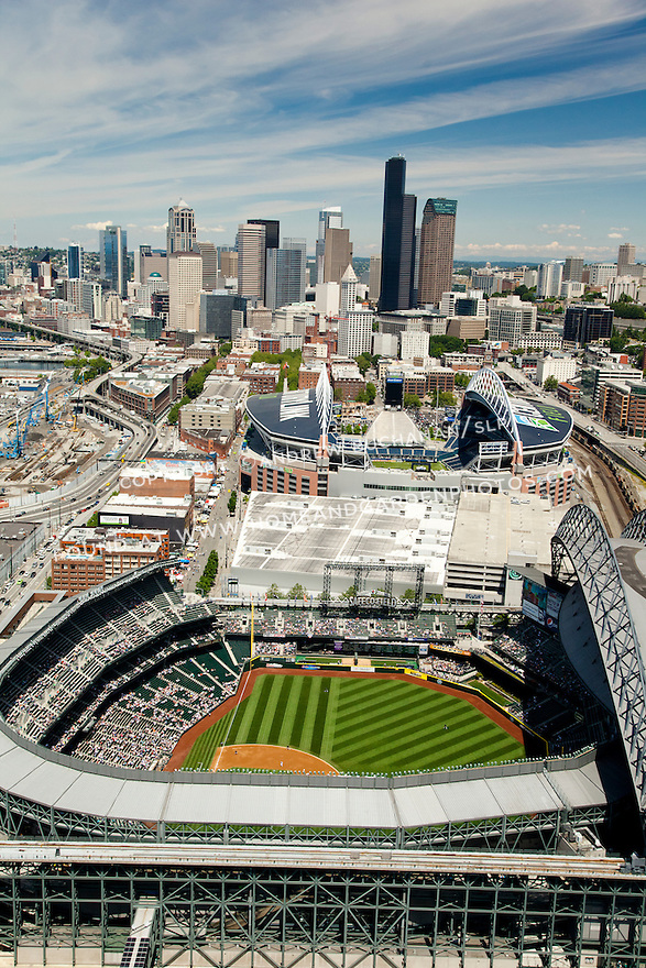 afternoon baseball game at Safeco Field, home of Major League Baseball's Seattle Mariners with Century LInk Field and downtown Seattle skyline behind; Seattle, WA