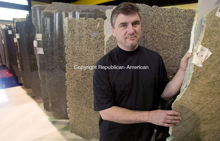 BEACON FALLS, CT. 07 May 2007-050707SV10--Patrick Schmitt, facilities Manager, stands in the show room with granite slabs at O&amp;G Industries in Beacon Falls Monday.<br /> Steven Valenti Republican-American