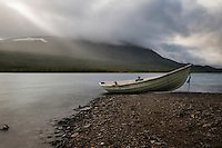 Row boat on shore of lake Teusjaure outside Teuesjaure hut, Kungsleden trail, Lapland, Sweden