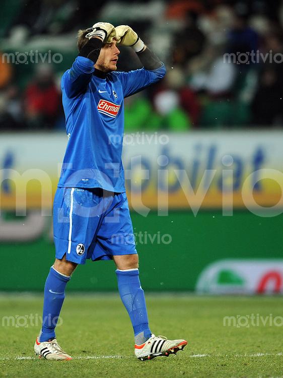 FUSSBALL   1. BUNDESLIGA   SAISON 2011/2012   21. SPIELTAG VfL Wolfsburg - SC Freiburg                                 10.02.201 Oliver Baumann (SC Freiburg) ist enttaeuscht