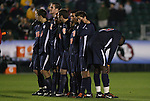 13 November 2009: Virginia players during the penalty kick shootout. Virginia's Tony Tchani (right) faces away from the goal. The University of Virginia Cavaliers defeated the Wake Forest University Demon Deacons 4-3 on penalty kicks after the game ended in a 0-0 tie after overtime at WakeMed Stadium in Cary, North Carolina in an Atlantic Coast Conference Men's Soccer Tournament Semifinal game.