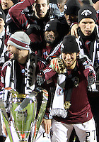 Kosuke Kimura 327 reaches out for the trophy During post game trophy Celebration after MLS Cup 2010 at BMO Stadium in Toronto, Ontario on November 21 2010.