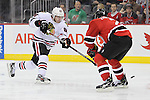 Mar 27; Newark, NJ, USA; Chicago Blackhawks right wing Patrick Kane (88) takes a shot while being defended by New Jersey Devils defenseman Marek Zidlicky (2) during the first period at the Prudential Center.