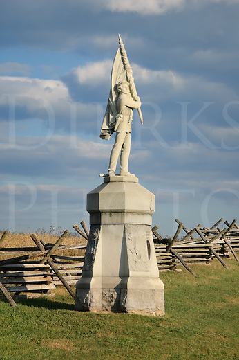 Antietam battlefield Civil War monument along Bloody Lane at the Sunken Road, a Union infantry soldier with flag, National Military Park, taken in late afternoon light, Sharpsburg, MD, USA.