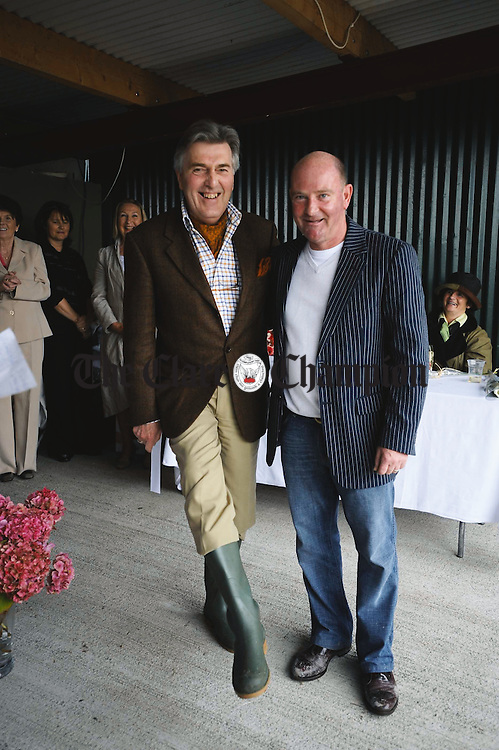 Nigel Bridge, with boots on, is congratulated by sponsor Tony Molloy after being announced as the Best Dressed Man at the Clare County Show in Ennis. Photograph by John Kelly.