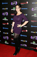 JESSICA TONDER .At SWAGG VIP Kid Rock Concert at the Joint inside the Hard Rock Hotel and Casino, Las Vegas, Nevada, USA,.7th January 2010..full length hand on hip purple bodycon dress black otk over the knee high boots tights .CAP/ADM/MJT.© MJT/AdMedia/Capital Pictures.
